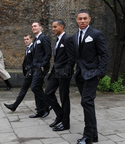 Arsenal players in suits: Alex Oxlade-Chamberlain, Theo Walcott, Thomas Vermaelen, Jack Wilshere.