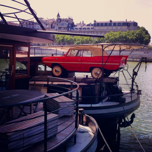 Spotted on the banks of the Seine, Paris: the ultimate houseboat tender - a 1961 Amphicar.
