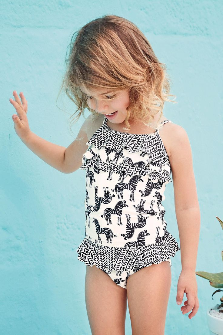 baby and newborn swimwear Let your little one loose on the beach in a swimsuit with built in UPF. Suits that cover their legs and arms give maximum protection under the sun, so your swimmer can get on with the important stuff – like building that sandcastle.