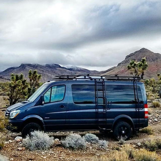 4x4 Mercedes Sprinter outfitted with Aluminess roof rack, ladder and surf pole.  Photo by @dadvanture on IG
