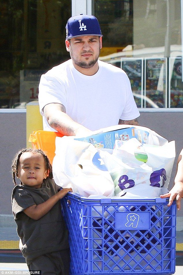 Skinny stepdad: Rob Kardashian cut a much slimmer frame as he took his girlfriend Blac Chyna's son King Cairo toy shopping on Wednesday