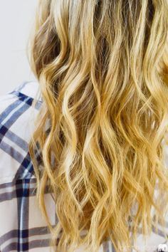 Discover how to use a curling wand to create natural looking waves in just a few simple steps with this hair tutorial.