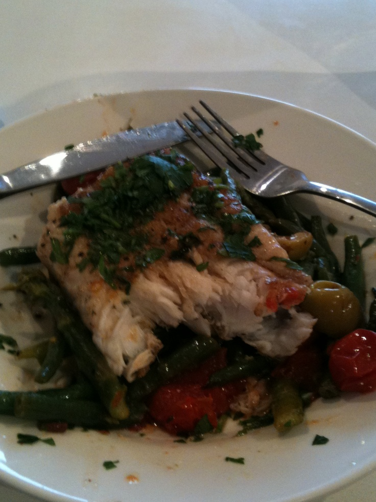 Baked fish, green beans, asparagus,cherry tomatoes, olives and basil.
