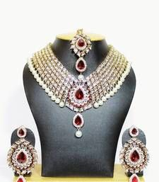 Kundan studded necklace set in maroon with pearls