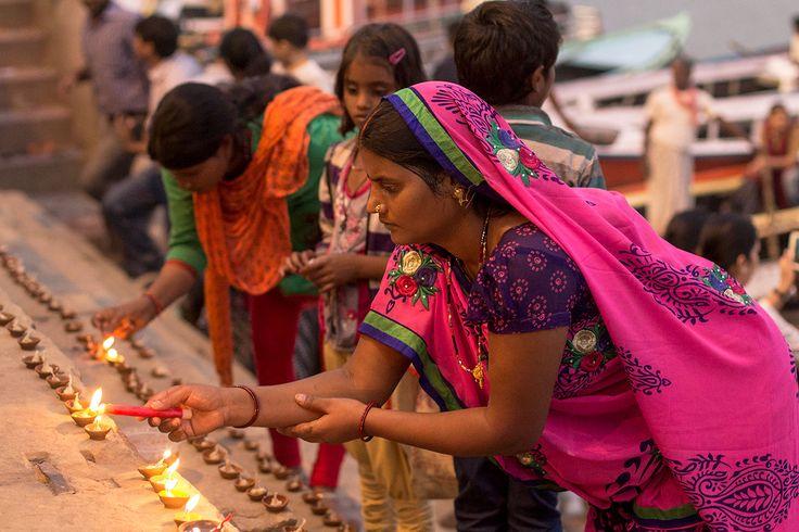 Lighting candles for Dev Diwali, Varanasi