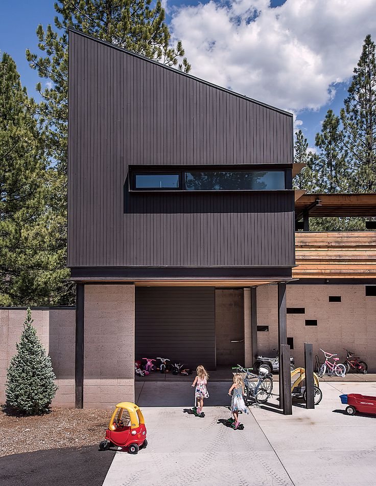 """The guesthouse hovers above the motor court. """"The main area was broken up into four zones: the kids wing, the guest suite, the master suite, and the living-dining room and kitchen, which is a transition area, where public meets private,"""" says Hawkins."""