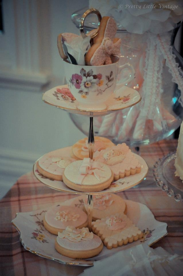 Vintage 3 tiered tea cup cake stand filled with vintage cookies for a thir.tea.th party by www.prettylittlevintage.com.au