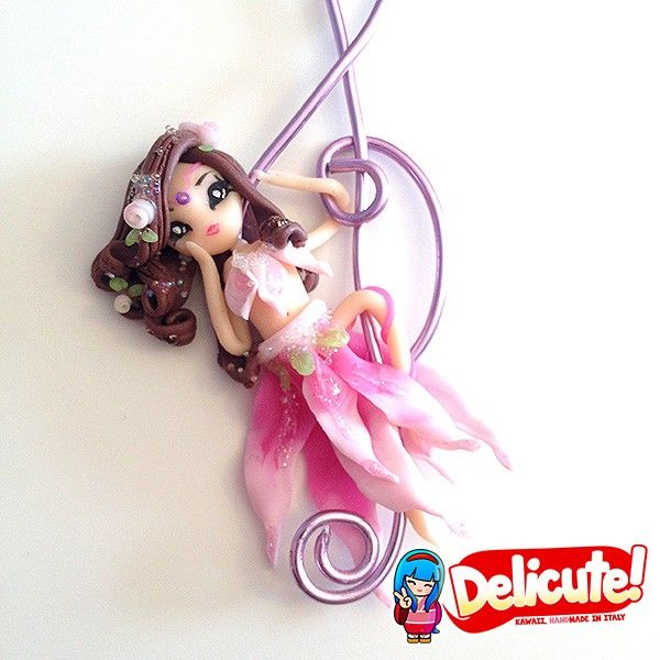 Romantic Wirabola fairy hanged on an artistic wire charm in the shape of treble clef, dangling on the chain of the necklace. These jewels are completely handmade, 100% Made in Italy with high quality materials. The pendant in artistic wire is made of anodized aluminum, modeled by hand.  Find it on www.Delicute.com