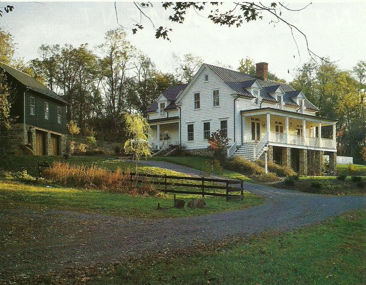 Southern Farmhouse. Has a Daylight Basement. White Lap Siding with Stone Foundations. Looks Similar to the house in the movie Cold Mountain. Detached Garage with Same Stone Foundation, but Different Board and Batten Siding.