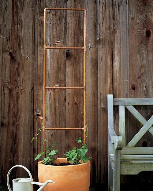 Copper plumbing doesn't have to be hidden in walls. In the garden, the tubing makes a handsome trellis that develops a natural patina with age. Arrange precut tubing from the hardware store into a ladder shape or other design, and use elbow and T pieces to connect the sections. Secure the joints with a heavy-duty adhesive. To trim lengths of tubing, use a pipe cutter, then a wire brush or metal file to sand off any burrs or sharp edges.