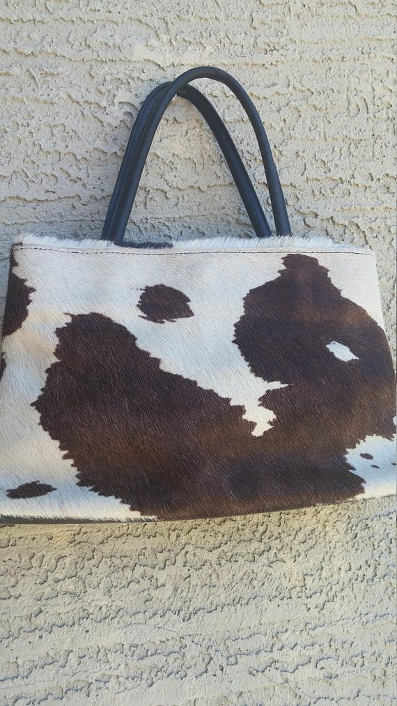 Check out this item in my Etsy shop https://www.etsy.com/listing/536719590/cowhide-leather-handbag-white-brown
