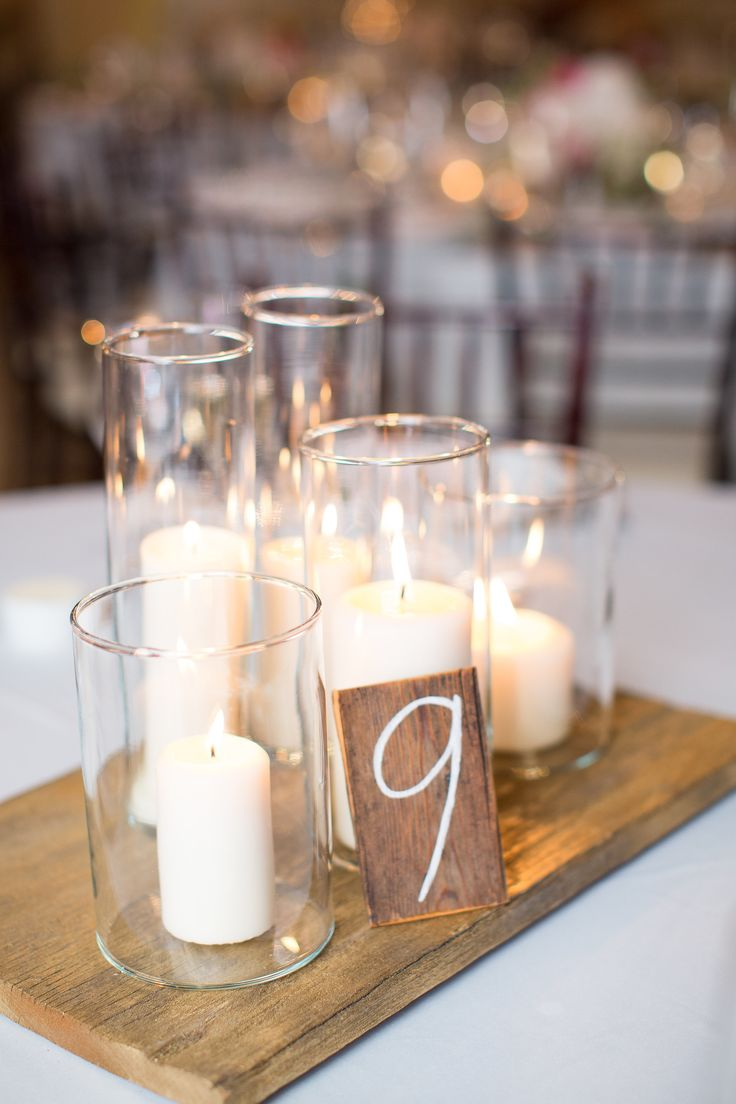 Groups of candles at a variety of heights. Mstarr Event Design.  Photography: Megan