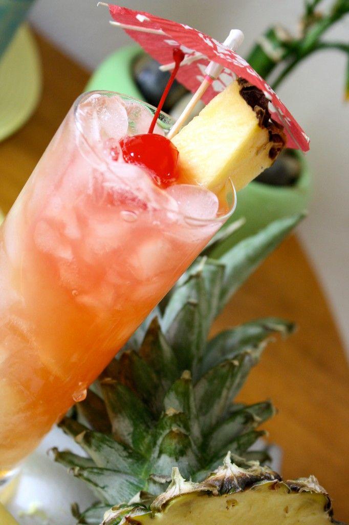 italian surfer - malibu rum; amaretto; pineapple juice; cranberry juice; ice; pineapple wedge