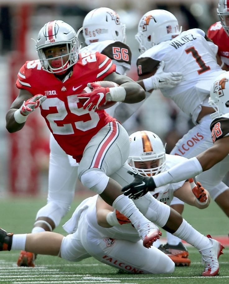 Ohio State Buckeyes running back Mike Weber (25) looks to break past Bowling Green Falcons defensive back Ben Hale (38) in the second quarter, Saturday,
