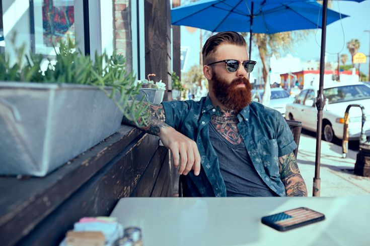 Bearded man with tattoos