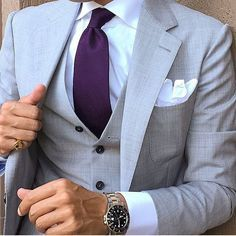 Light grey suit and purple tie
