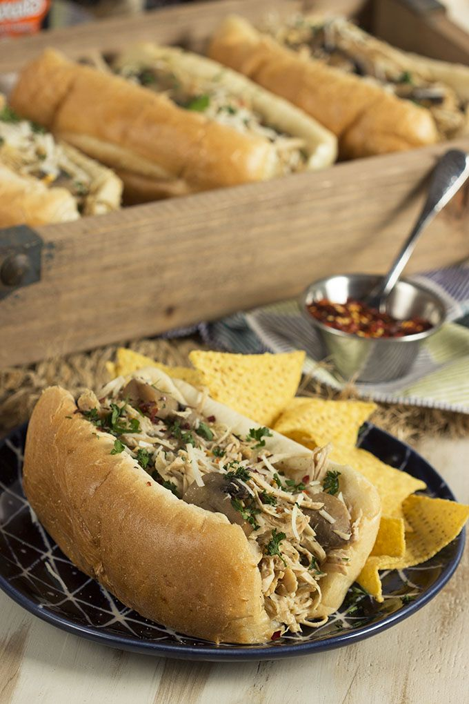 Super easy and healthy, these simple to make Slow Cooker Chicken Philly Cheesesteaks are a great way to feed a crowd at any party or tailgate. So great for football watching parties!   @suburbansoapbox