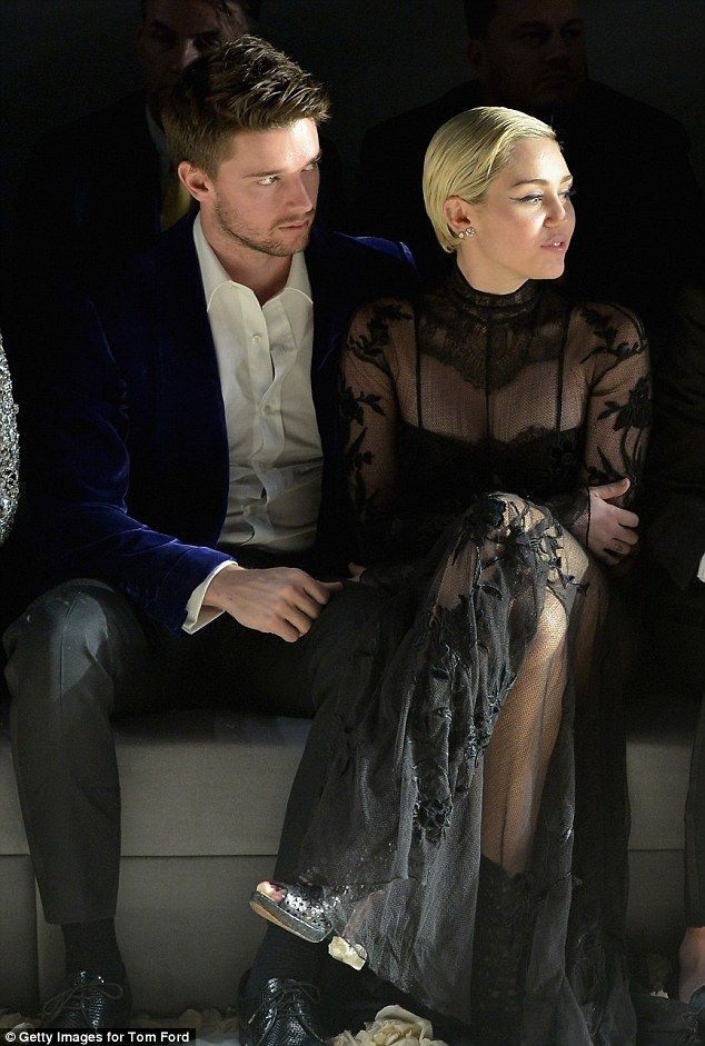 Miley Cyrus and Patrick Schwarzenegger turned a night all about fashion into a celebration of their love at the Tom Ford show in Los Angles, California, on Friday night