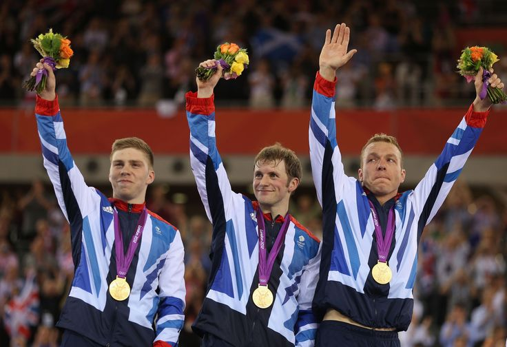 Philip Hindes, Chris Hoy, Jason Kenny celebrating their gold medal in the mens team sprint