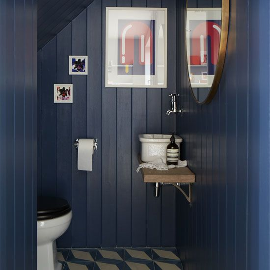 Loo under the stairs: love the navy tongue and groove and the basin on the shelf.