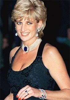 Princess Diana's classic combination of her pearl chocker with central sapphire and diamond cluster, worn along with her fantastic sapphire and diamond cluster engagement ring.