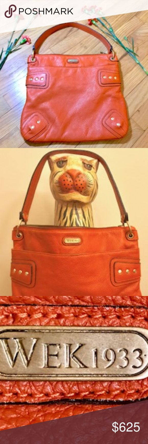 WEK1933 Handbag by Alek Wek Orange Pebble Leather Shoulder Bag. Rare & beautiful!  In 2002 Sudanese born supermodel, artist, author & designer Alek Wek launched an exclusive handbag collection named after the year her father was born. W/special attention to design, detail, hardware & material the bag is very much uniquely one-of-a-kind. Zips at top; inside side pocket that zips. Front pocket w/magnetic closure & back zip pocket.  Like new - slight spot shown in last pic-is on the upper left…