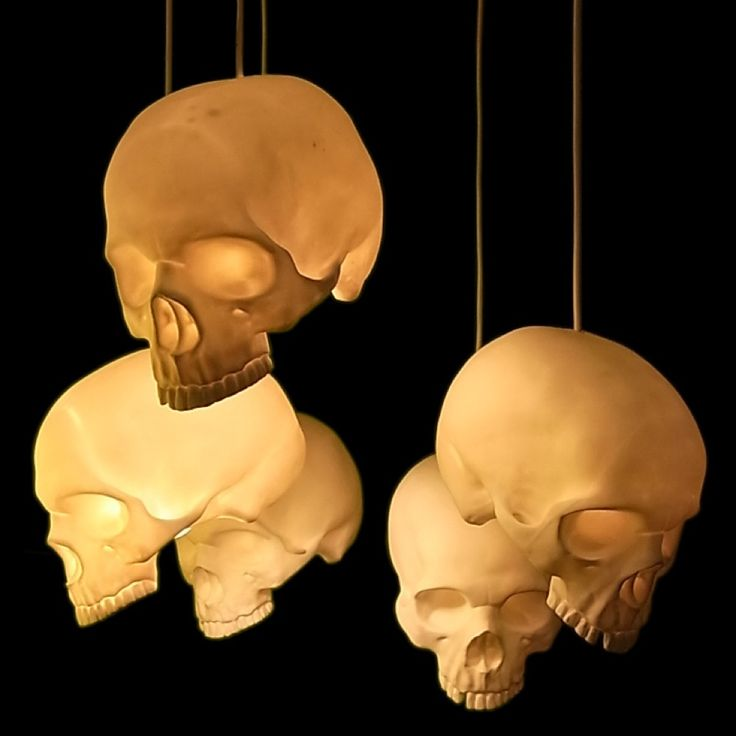 Get some cheap skeletons and put a light in them and hang for a different Halloween decoration. We want these #skulls in our #house all year long!