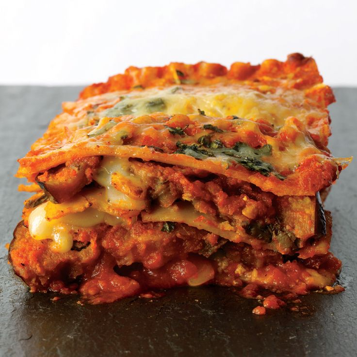 Eggplant Parmesan Lasagna 1 tsp olive oil, divided 1 eggplant (about 1 lb), sliced crosswise into 1/4-inch-thick rounds 1 jar (26 oz) cabernet marinara sauce 6 uncooked whole-wheat lasagna noodles 1 cup part-skim ricotta cheese 1 log (3.5 oz) soft goat cheese, room temperature 1/3 cup chopped fresh basil, divided 1/4 tsp crushed red pepper flakes 1/4 cup shredded Parmesan cheese