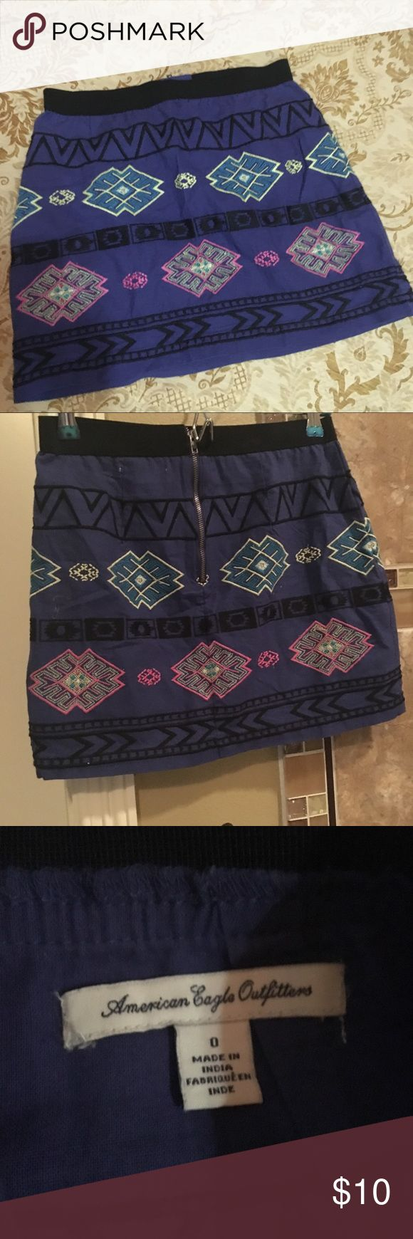 Cute mini skirt Elastic waist back zipper... color as picture between purple and violets with pink and yellow and black embroidery American Eagle Outfitters Skirts Mini