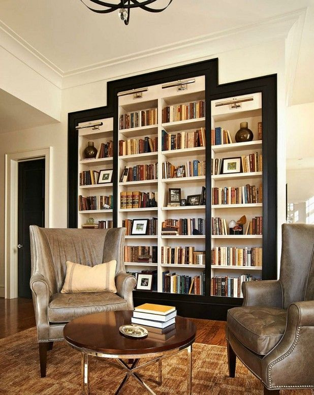 Interior. How To Embellish Your Reading Space With Scandinavian Bookshelves Ideas. Bookshelves Design Style With Open Wall Bookshelves And White Massive Shelf And Black Modular Frames Together With White Wall Paint And Also Twin Leather Arms Chairs And Nail Head Trim As Well As Brown Throw Pillows And Also Rounded Wooden Coffee Table And Brown Motive Carpet And Laminate Timber Flooring