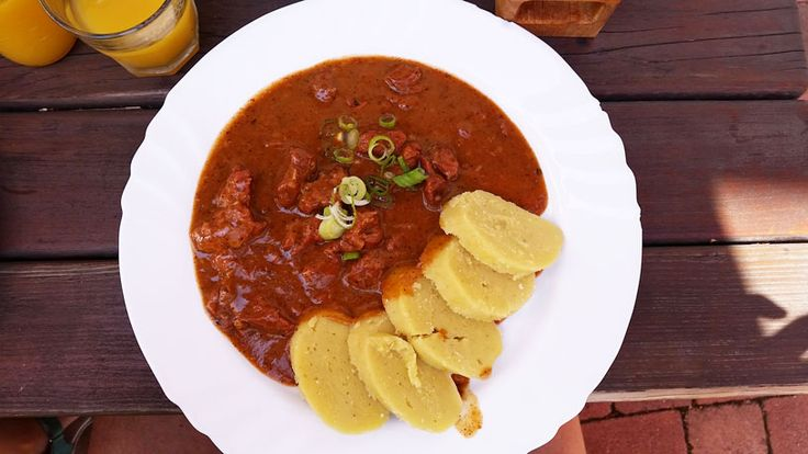 Beef Goulash served only with potato dumplings with a white onion garnish. There was nothing left on the plate I can tell you.
