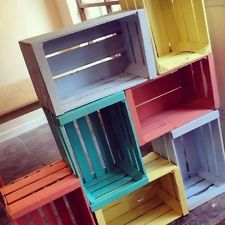 LOVE the idea of screwing together crates like this!  Would make a great storage/display for a market -- but it isn't convenient to transport (unless you could lay it flat and have stock stored inside?).  So easy and  rustic and cute depending on how you paint the crates -- I like the varied colors, and would love sanded white, too.  ...This would also make an adorable storage divider wall for a yoga studio or for kid stuff!