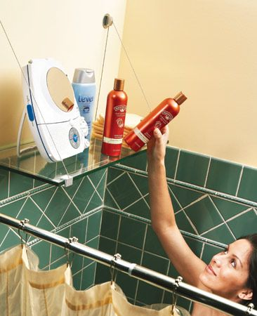 Store shower supplies on a handy shelf Tempered safety glass shelf on a cable shelf bracket. The cable shelf bracket requires only two screws for support. If studs aren't located in the right positions, use toggle bolts to anchor the shelf brackets. The glass hangs on the cables.