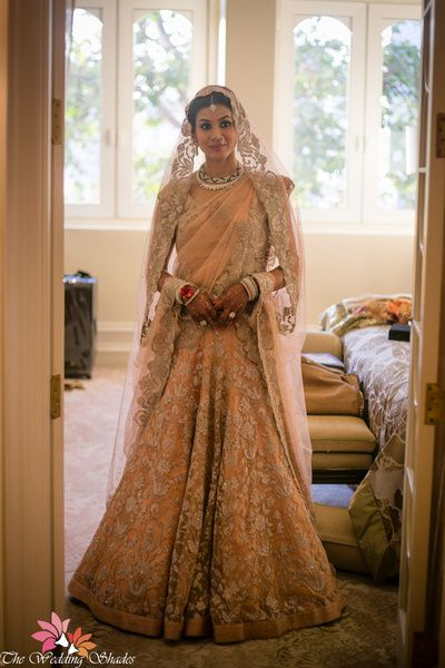 Sangeet Lehengas - Peach and Silver Lehenga | WedMeGood | Scalloped cutwork Dupatta, Peach Lehenga with Silver Embroidery #wedmegood #bridal #lehenga #indianbride #indianwedding #pastel