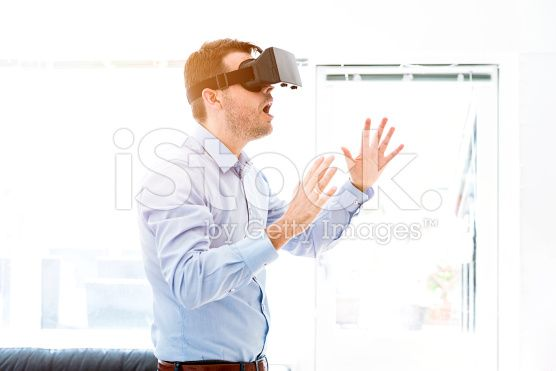 Man is surprised while using a virtual reality headet royalty-free stock photo