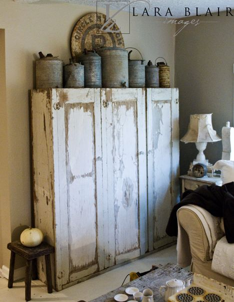 Primitive Cabinet ...good storage, old but user friendly. Nice combination with the galvanized metal collection on top.