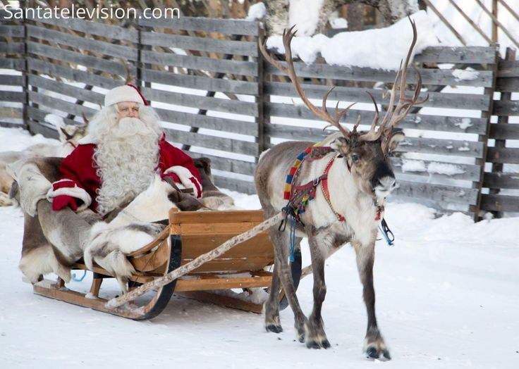 Santa Claus having a reindeer ride in Santa Claus Village in Rovaniemi in Finland