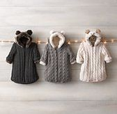 Going along with my theme of giving new babies a totally impractical, yet delightful, 1st taste of luxury-these faux fur lined, cable knit buntings are luxe, gorgeous, very practical for long Winters, especially for Northerners, and the new Mommy will be delighted, I promise.  Sale | Restoration Hardware Baby & Child