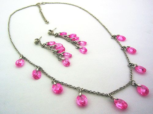 Sterling Silver Necklace with Pink Simulated Diamonds, which comes with earrings.