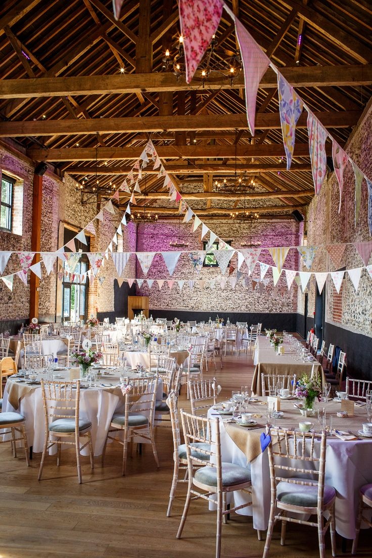 Rustic Barn Reception full of DIY Decor | Bunting  | Ian Stuart Bridal Gown | Rustic Wedding in a Barn in | Hand Sewn Cobalt Blue Bridesmaid Dresses | DIY Wild Flowers | Images by Lina & Tom | http://www.rockmywedding.co.uk/emily-luke/