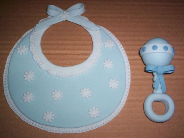 Baby Rattle Cake Decoration : Fondant rattle and baby bib. Cake Decoration Pinterest ...