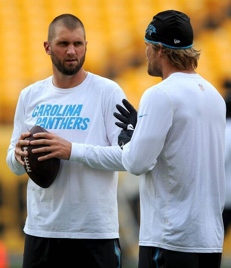 Carolina Panthers quarterback Derek Anderson, left, and tight end Greg Olsen, right, talk prior to the team's preseason game vs the Pittsburgh Steelers on Thursday, September 3, 2015 at Heinz Field in Pittsburgh, PA.