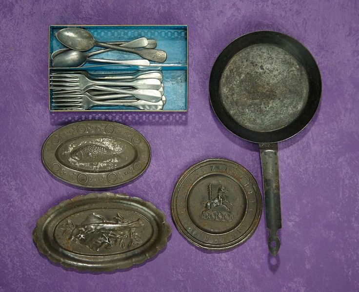 Elan Auction - June 10-11, 2017 | German Tinplate Toy Trays and Blue Metal Cutlery Tray with Pewter Forks and Spoons. $400/500