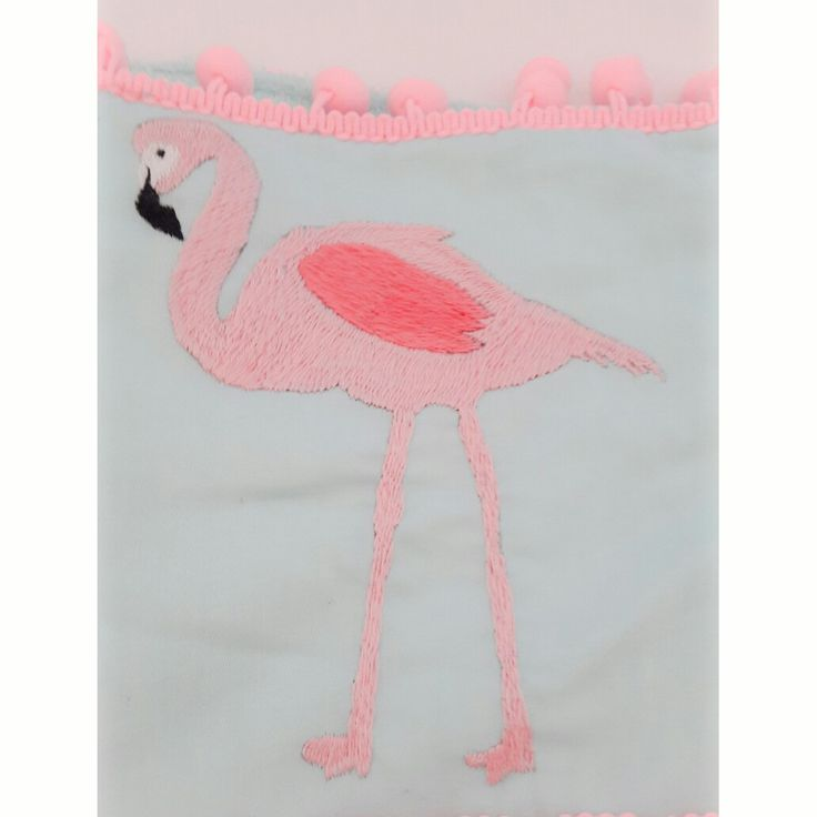 Embroidered flamingo on a beach towel