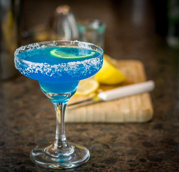 A Blue Moon martini made with vodka, blue curacao and lime...Try some today at The Lounge.