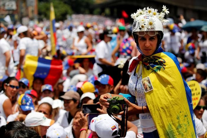 Roses in hand, Venezuelan women protesters face security forces   Reuters