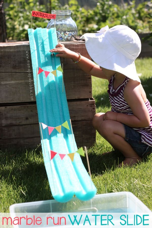 A fun way to spend a summer afternoon: make your own DIY marble run water slide.#makeit