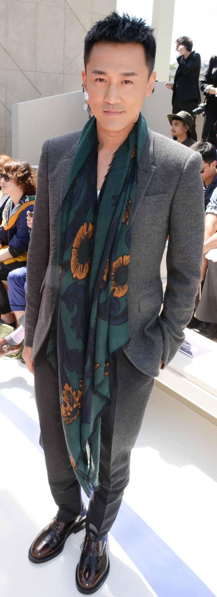 Hong Kong actor Raymond Lam wearing Burberry tailoring and a printed scarf after the Burberry S/S15 show in London
