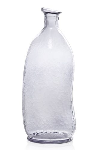20 Party Decorations For Decor Snobs - In place of a traditional carafe, we love this organic glass bottle for decanting drinks.  FRENCH CONNECTION HOME, MOTTLED GLASS DECANTER, £25, AVAILABLE AT FRENCH CONNECTION.