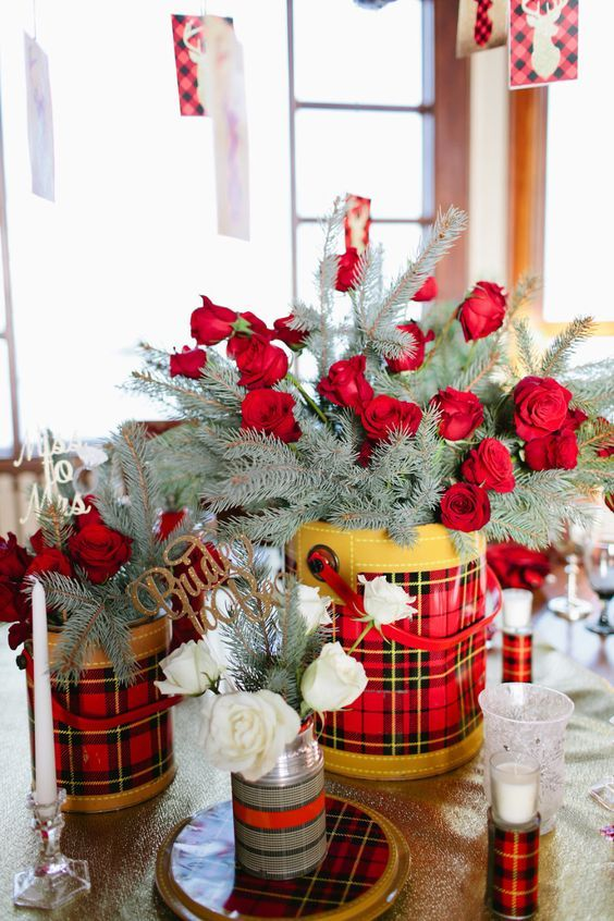 Winter rose bouquet with evergreen in flannel print bucket for Winter bachelorette party ideas